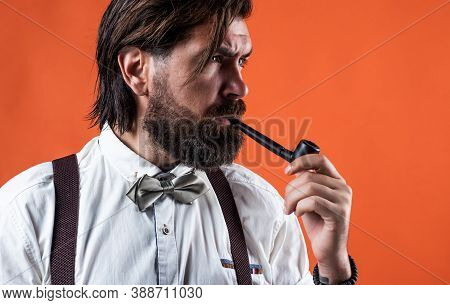 Charisma. Confident And Elegant Man In Classical Wear Smoke Pipe. Masculinity And Charisma. Formal M