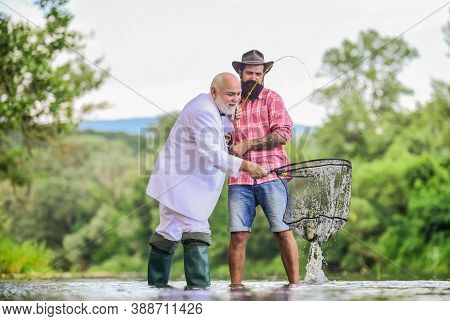 Granddad And Drandson Fishing. Fisher Celebrate Retirement. Good Production. Fishermen. Successful C