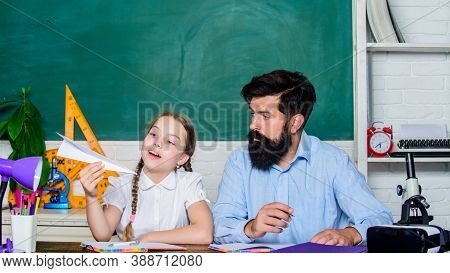 Creating A Community Of Learners. Teacher And Schoolgirl. Man Bearded Pedagogue And Pupil Having Fun