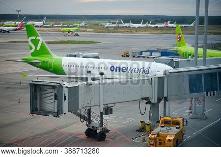 S7 Airlines Original Colorway Planes And Ground Services At Airfield. Domodedovo Airport, Russia - A