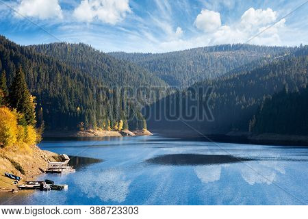 Mountain Lake In Autumn Season. Beautiful Countryside Scenery On A Sunny Morning. Bright Blue Sky Wi