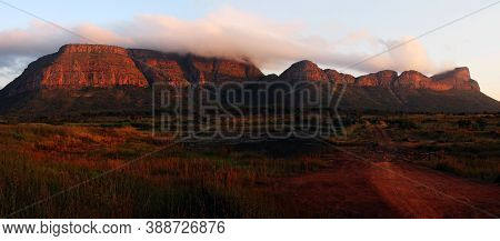 Rock In The Northern Part Of South Africa.large Red Mountains In South Africa In The Setting Sun. Mo