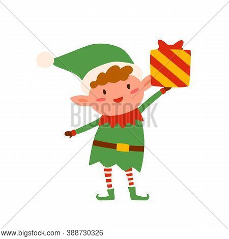 Cute Christmas Elf Holding Present Decorated With Bow. Happy Childish Xmas Dwarf With Wrapped Giftbo