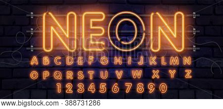 Orange Neon Font, Complete Alphabet And Numbers. Glowing Alphabet, Electric Stand, Against A Brick W