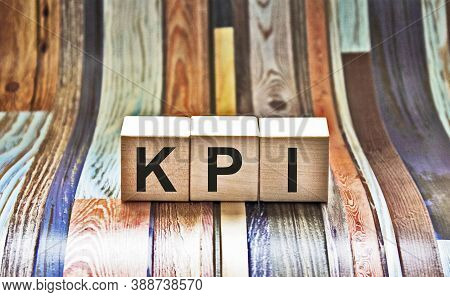 Kpi - Wooden Blocks With Letters, Key Performance Indicator Kpi Concept, Top View On Grey Background