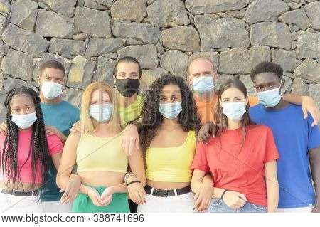 Millennial People From Diverse Cultures And Races Looking At Camera With Protective Masks For Corona