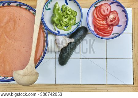 Gazpacho, Andalusian And Some Ingredient To Prepare It, Such As Tomato, Garlic And Onion, Cucumber,
