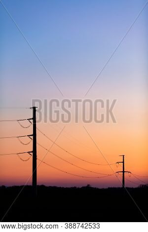 Silhouette Of Power Lines Over Colorful Clear Sky At Sunrise Or Sunset, Blackout Concept.