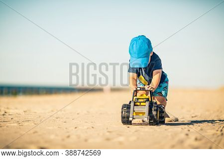 Toddler Boy Playing With Toys On A Sunny Beach. Little Child Walking On Sand. Beautiful Inspirationa