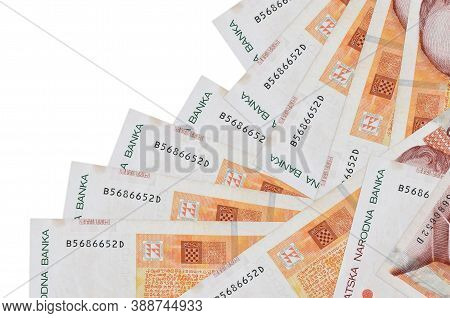 100 Croatian Kuna Bills Lies In Different Order Isolated On White. Local Banking Or Money Making Con