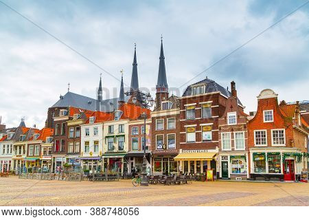 Delft, Netherlands - April 8, 2016: Colorful Street View With Traditional Dutch Houses, Cathedral Sp