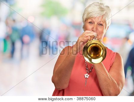 Mature Woman Blowing Her Trumpet, Outdoor