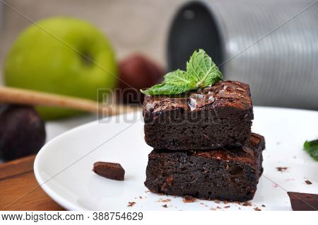 Close Up Stack Of Homemade Fudge Brownies On Plate