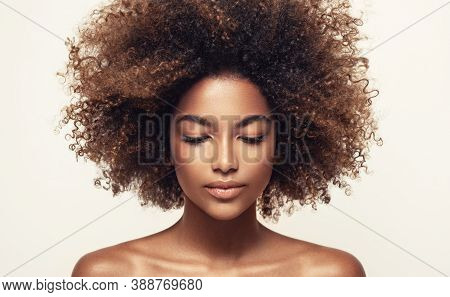 Beauty Portrait Of African American Girl With Clean Healthy Skin   Beautiful Black Woman.curly Afro