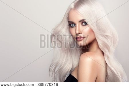 Beautiful Girl With Hair Coloring In Ultra Blond. Stylish Hairstyle Curls Done In A Beauty Salon. Fa