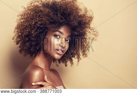 Beauty Portrait Of African American Girl  With Afro Hair . Beautiful Black Woman . Cosmetics, Makeup
