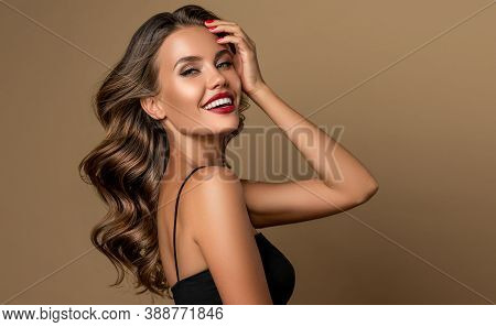 Beautiful Smiling Woman. Beauty Girl  With Curly Hair   . Presenting Your Product. Expressive Facial