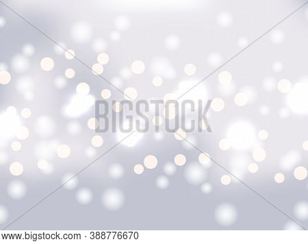 White And Silver Bokeh Background. Holiday Glowing White Lights With Sparkles. Festive Defocused Lig