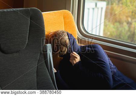 Young Woman Traveler Sleeping Inside Of Suburban Train.