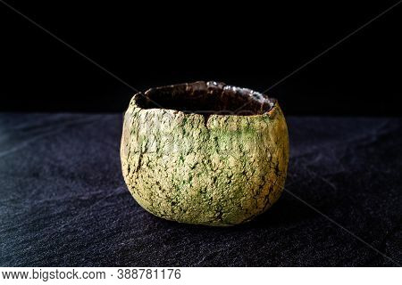 Handmade Ceramic Pottery Cup / Handcrafted Bowl On Dark Surface And Background.