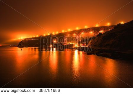 Composition About Wildfires And Climate Change Concept. Night Orange Sky Of San Francisco Golden Gat