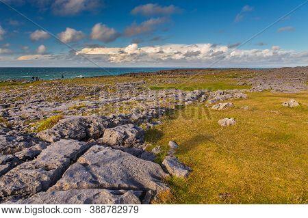 Coast Atlantic Ocean, Ireland- 07 November2015: People On The Rocky Coast Of The North Atlantic Ocea