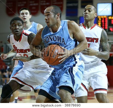 NEW YORK-NOV 3: Sonoma State Seawolves guard Patrick Scott drives to the basket against the St. John's Red Storm at Carnesecca Arena on November 3, 2012 in Jamaica, Queens, New York.