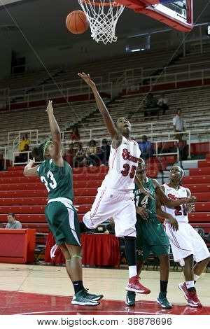 NEW YORK-NOV 3: St. John's Red Storm guard Shenneika Smith (35) goes up for a basket against Farmingdale Rams during the first half at Carnesecca Arena on November 3, 2012 in Jamaica, Queens, New York.