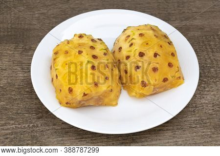 Peeled Pineapple And Cut In Half In A Plate, Tasty And Juicy Pineapple, Benefits Of Pineapples. Wood