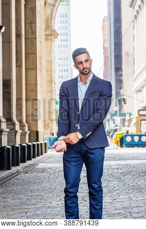 Young East Indian American Man With Beard Traveling In New York City, Wearing Blue Suit, White Shirt