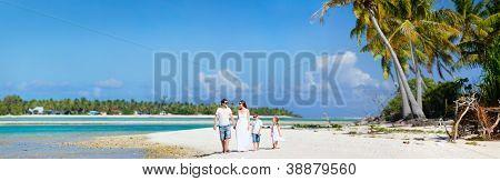 Panoramic photo of beautiful Caucasian family on beach vacation