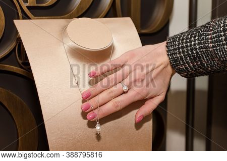 Young Woman Choosing Ring In Jewelry Store. Hand Of Female Customer In Jewelry Shop. Trying A Diamon