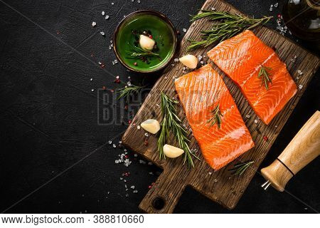Raw Salmon Fish, Fresh Salmon Fillet At Cutting Board With Ingredients For Cooking. Top View With Co