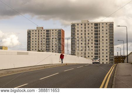 Doncaster,yorkshire, England - October 7, 2020. Man Walking On S. James Bridge With View Of Tall Bui