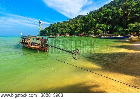 Diesel Engine Traditional Thai Long-tail Diesel Boat In Moken Tribe Village Of Sea Gypsies And Andam