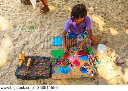 Surin Islands, Ko Phra Thong, Thailand - January 3, 2016: Top View Of A Sea Gypsies Little Girl Sell