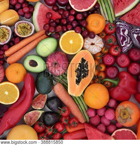 Plant based vegan foods high in lycopene with fruit & vegetables. Also high in antioxidants, anthocyanins, vitamins, fibre, minerals, carotenoids & fibre. Beneficial for heart health. Flat lay.