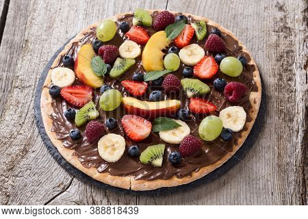 Fruit Pizza With Nut Nougat Cream , Fruit And Berries