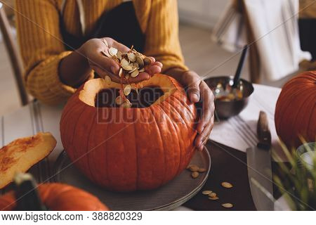 Woman Making Pumpkin Jack O'lantern At Table, Closeup. Halloween Celebration