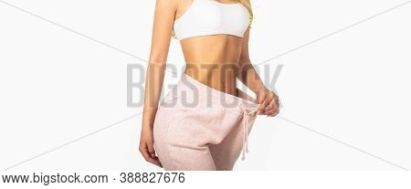 Woman Showing Slim Body After Sport Trainings, Healthy Eating. Weight Loss Concept. Thin Woman In Bi