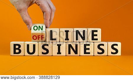 Time To Online Business. Male Hand Turns The Cube And Changes The Expression 'offline Business' To '