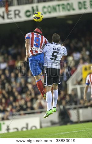 VALENCIA - NOVEMBER 3: Falcao #9 & Gago during Spanish Cup match between Valencia CF and AT Madrid, on November 3, 2012, in Mestalla Stadium, Valencia, Spain