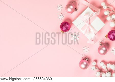 Christmas Falt Lay Background With Present Box And Decorations On Pink Background. Image With Copy S