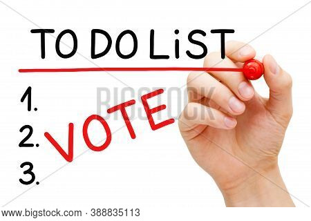Hand Writing The Word Vote In To Do List With Red Marker Isolated On White Background. Elections Par