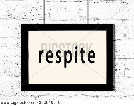 Black Wooden Frame With Inscription Respite Hanging On White Brick Wall