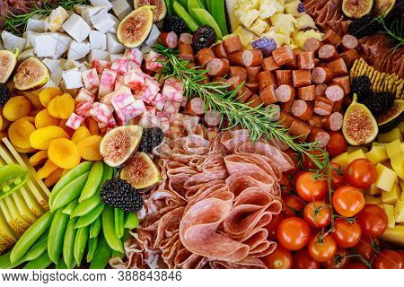 Variety Or Assortment Of Cheese, Fruits And Deli. Close Up.