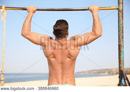 Handsome Man With Slim Body Doing Pull-ups