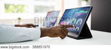 Predictive Business Analytics. African American Analyst Using Computer