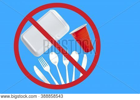 Single Use Plastic Cutlery, Styrofoam Takeaway Boxes And Plastic Glass On A Blue Background. Concept