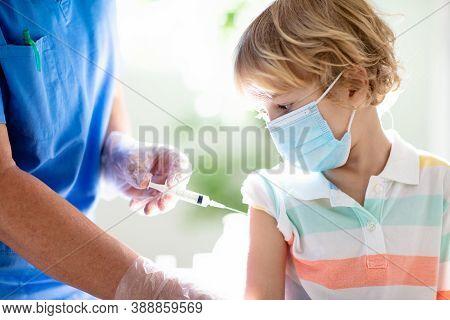 Coronavirus Vaccination. Covid-19 Vaccine. Doctor Vaccinating Child. Kids At Clinic. Little Boy Gett